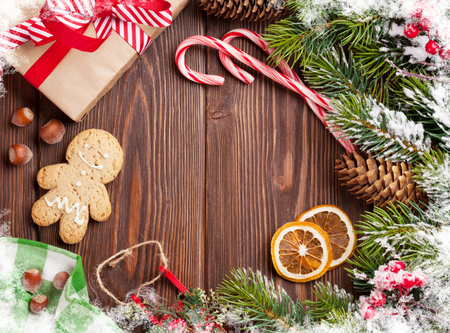 background box: Christmas wooden background with snow fir tree, decor and gift box
