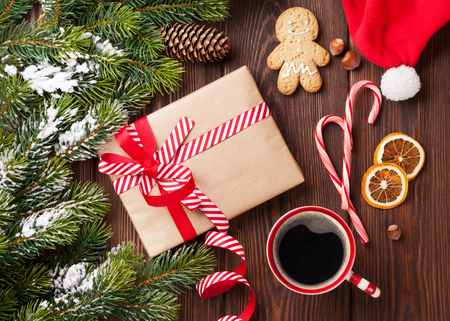 coffee tree: Christmas tree branch with snow and gift box. Top view Stock Photo