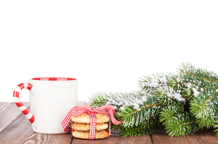 christmas winter: Christmas tree branch, cookies and mulled wine cup. Isolated on white background Stock Photo