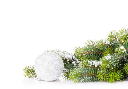 christmas tree branch: Christmas tree branch with snow and bauble. Isolated on white background with copy space