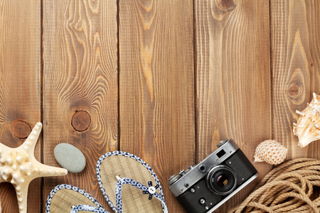 Travel and vacation items on wooden table. Top view with copy space Reklamní fotografie - 46103978