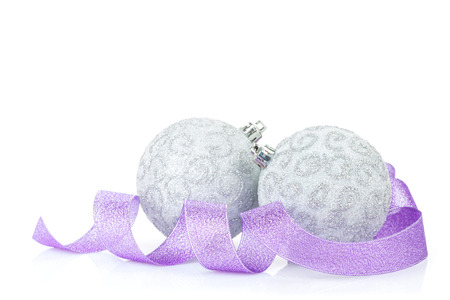 christmas baubles: Christmas baubles and purple ribbon. Isolated on white background Stock Photo