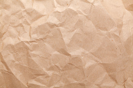 crumbled: Rumpled brown cardboard paper texture