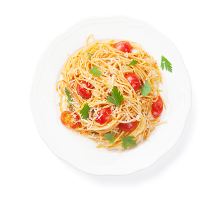 spaghetti: Spaghetti pasta with tomatoes and parsley. Isolated on white background