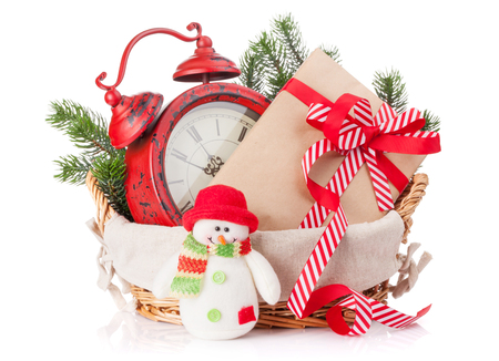 basket: Christmas gift box, alarm clock and snowman toy. Isolated on white background
