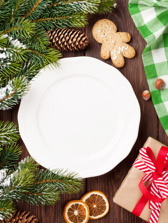 food plate: Christmas tree branch, empty plate and coffee. Top view with copy space