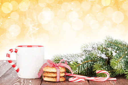 gingerbread cookie: Christmas tree branch, cookies and mulled wine cup with bokeh background