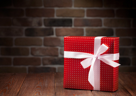 christmas gift box: Christmas gift box on wooden table. View with copy space
