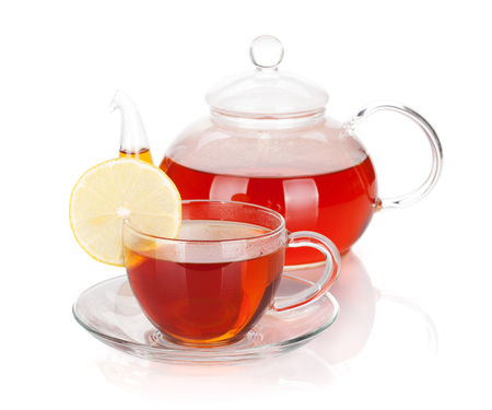 yellow tea pot: Glass teapot and cup of black tea with lemon slice. Isolated on white background