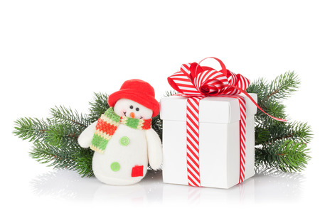 white winter: Christmas gift box, snowman toy and fir tree branch. Isolated on white background