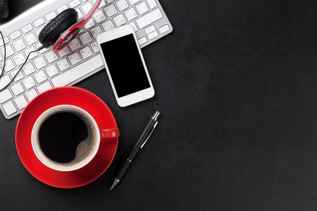 Office leather desk table with coffee cup, computer, smartphone and headphones. Top view with copy space Banque d'images