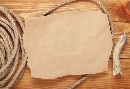 antique map: Old paper for copy space and rope on wooden textured background Stock Photo