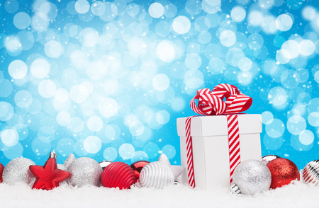 christmas gift box: Christmas background with baubles, gift box and bokeh copy space