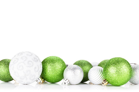 christmas baubles: Green and silver christmas baubles. Isolated on white background