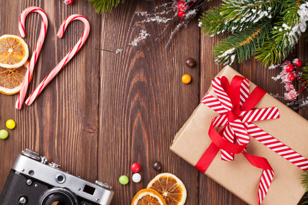 christmas gift box: Christmas background with gift box, camera and fir tree branch Stock Photo