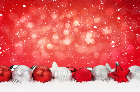 christmas balls: Christmas background with baubles in snow and bokeh copy space