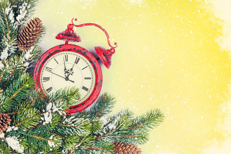 red and gold: Christmas background with alarm clock, pine tree branch and copy space