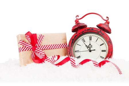 clock: Christmas gift boxe and alarm clock in snow. Isolated on white background Stock Photo