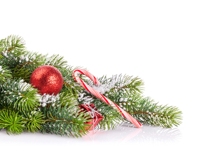 branche sapin noel: Christmas tree branch with snow and decor. Isolated on white background with copy space Banque d'images