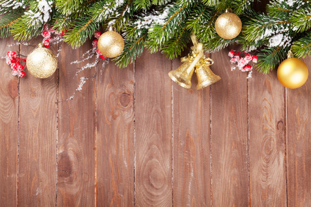 christmas decor: Christmas wooden background with snow fir tree and decor. View with copy space