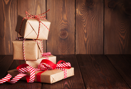 copy christmas: Christmas gift boxes on wooden table with place for copy space