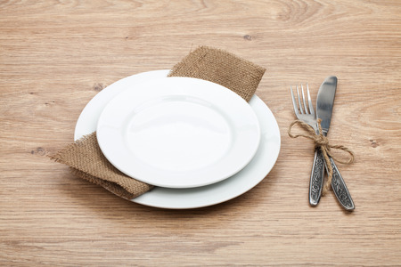 cutleries: Empty plate and silverware set on wooden table