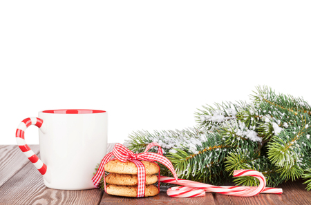 christmas tree branch: Christmas tree branch, cookies and mulled wine cup. Isolated on white background Stock Photo