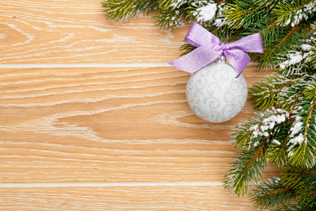morado: Christmas wooden background with snow fir tree, decor and copy space