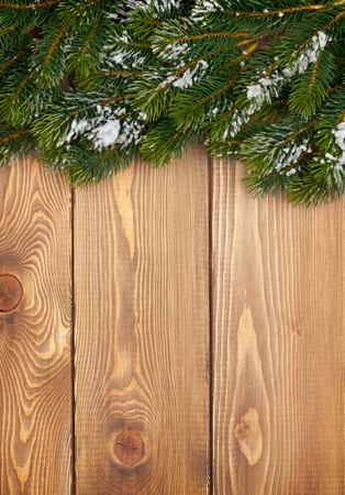christmas table: Christmas fir tree with snow on rustic wooden board with copy space Stock Photo