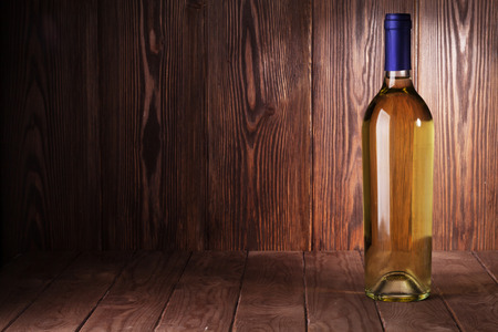 glass table: White wine bottle on wooden table. View with copy space Stock Photo