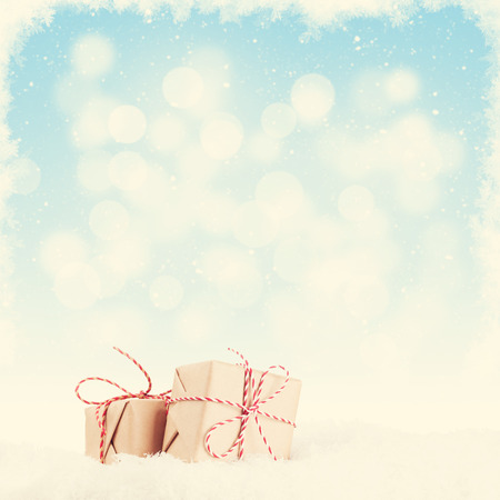 gift boxes: Christmas gift boxes in snow with background for copy space. Retro toned