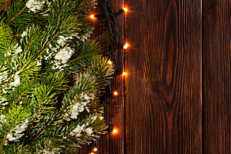 retro christmas tree: Christmas tree branch and lights on wooden background. View with copy space Stock Photo