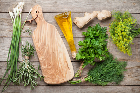 olive green: Fresh garden herbs on wooden table. Top view with copy space
