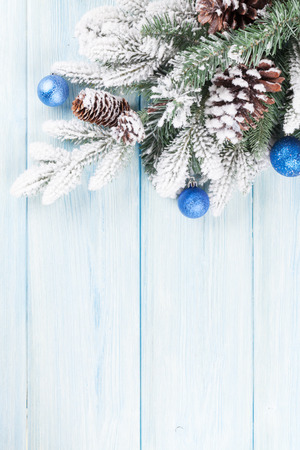 white space: Christmas wooden background with snow fir tree and decor Stock Photo