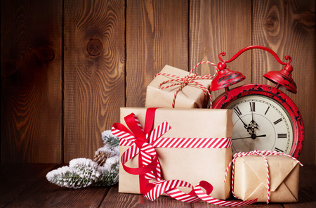 gift: Christmas gift boxes, fir tree and alarm clock