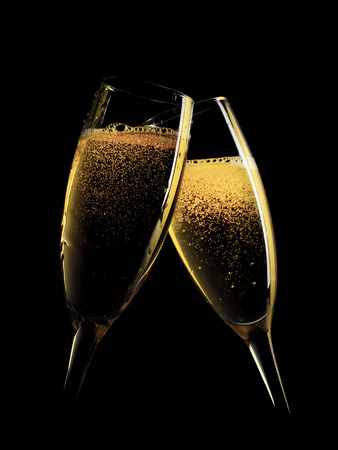 Two champagne glasses. Isolated on black background