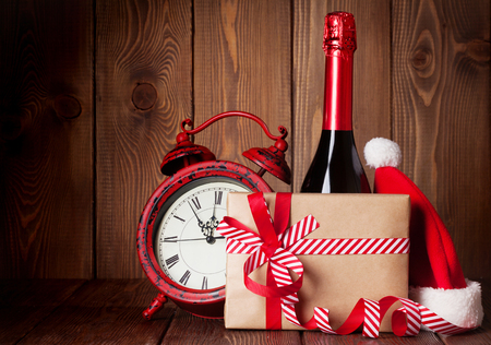 christmas hat: Christmas gift box, alarm clock, santa hat and champagne bottle