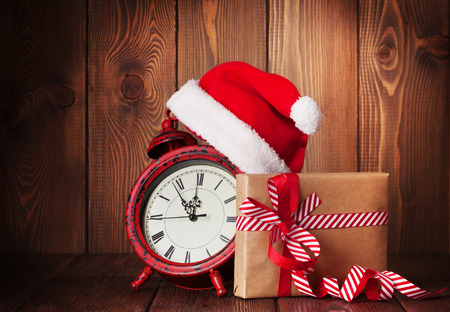 twelve month old: Christmas gift box, alarm clock and santa hat. View with copy space