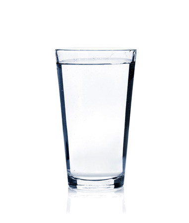 Glass of still water. Isolated on white background