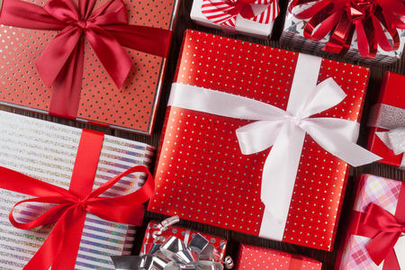 many: Christmas gift boxes on wooden table. Top view closeup Stock Photo