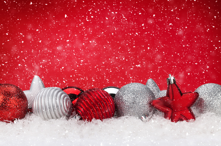 festive background: Christmas background with baubles in snow and copy space