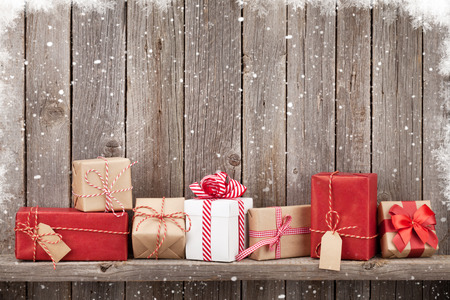 christmas red: Christmas gift boxes in front of wooden wall with copy space