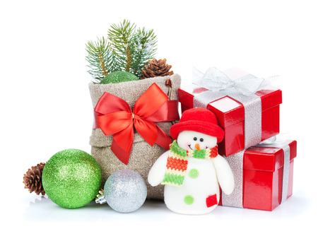 Christmas gift boxes, decor and snowman toy. Isolated on white background