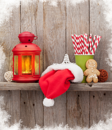 christmas decor: Christmas candle lantern and decor in front of wooden wall