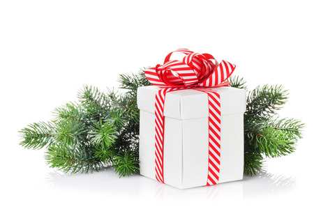 christmas gift: Christmas gift box and fir tree branch. Isolated on white background