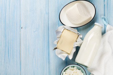 Dairy products on wooden table. Milk, cheese, curd cheese and butter. Top view with copy space Stock Photo