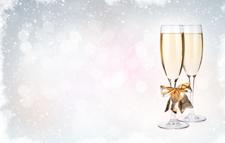 copy space: Two champagne glasses over christmas background with copy space