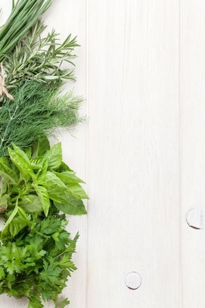 Fresh garden herbs on wooden table. Top view with copy space