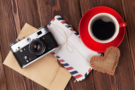 valentines background: Valentines day toy heart, retro camera, coffee cup and letters Top view Stock Photo