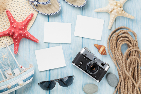 Travel and vacation photo frames and items on wooden table. Top view Stock Photo